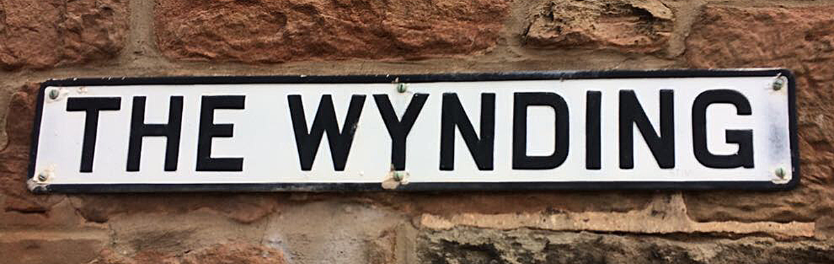 banner-wynding-road-sign